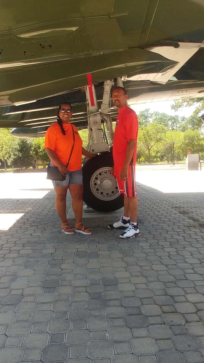Couple underneath plane or helicopter