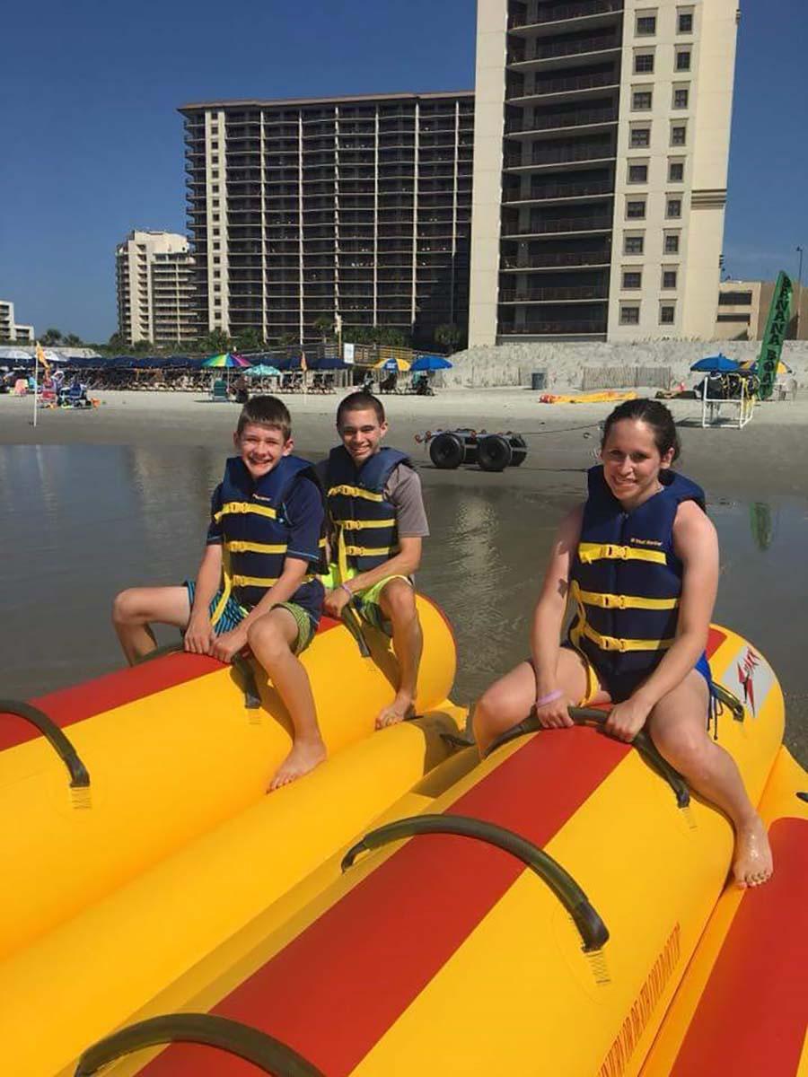 Family sitting on banana boat