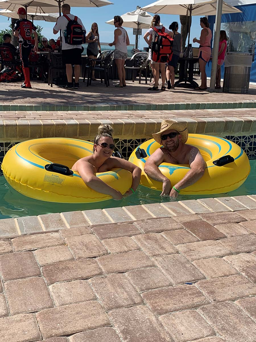 couple on floating down lazy river