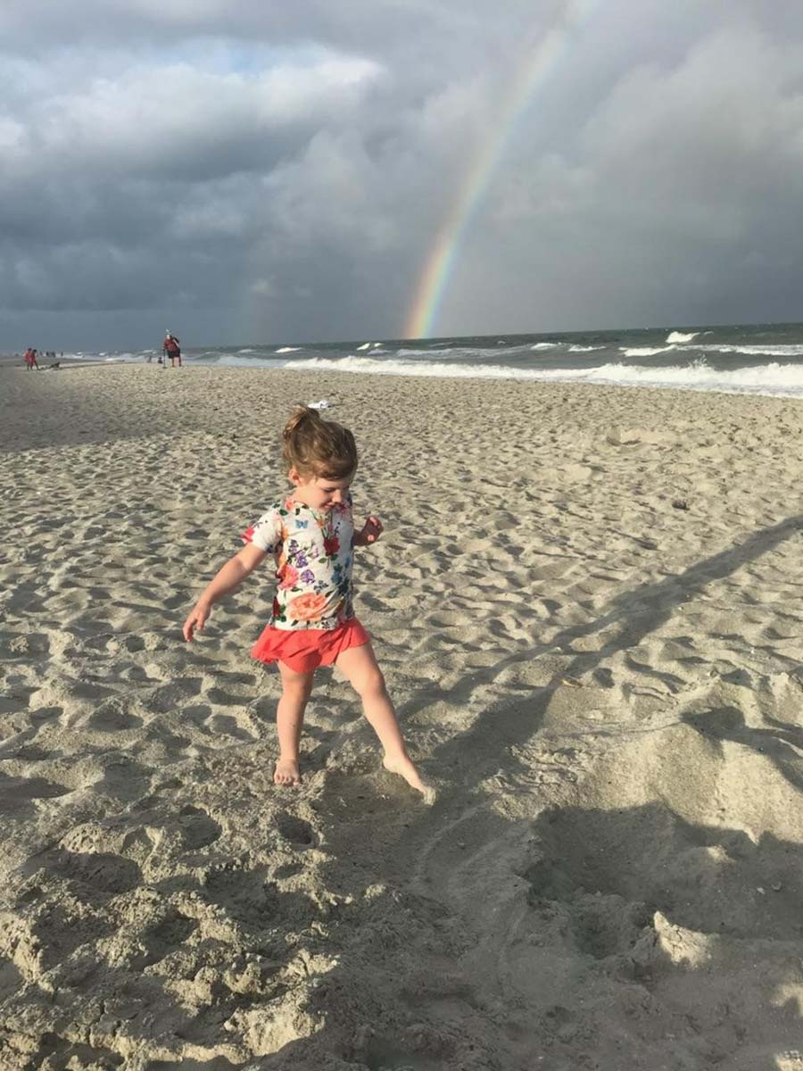 Little girl dancing in the sand