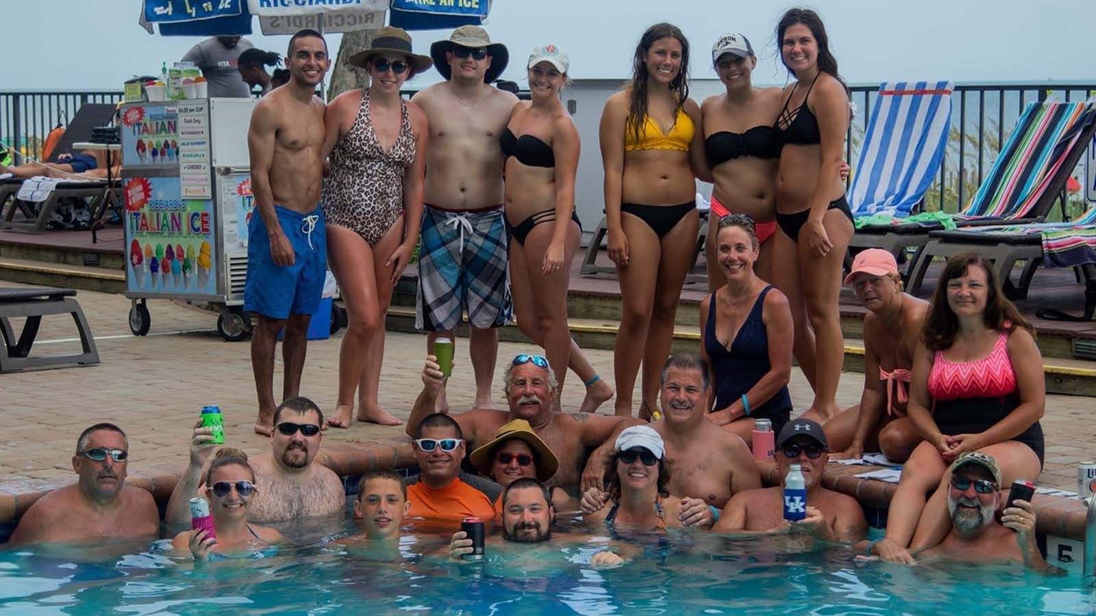 Big group posing for picture at the pool