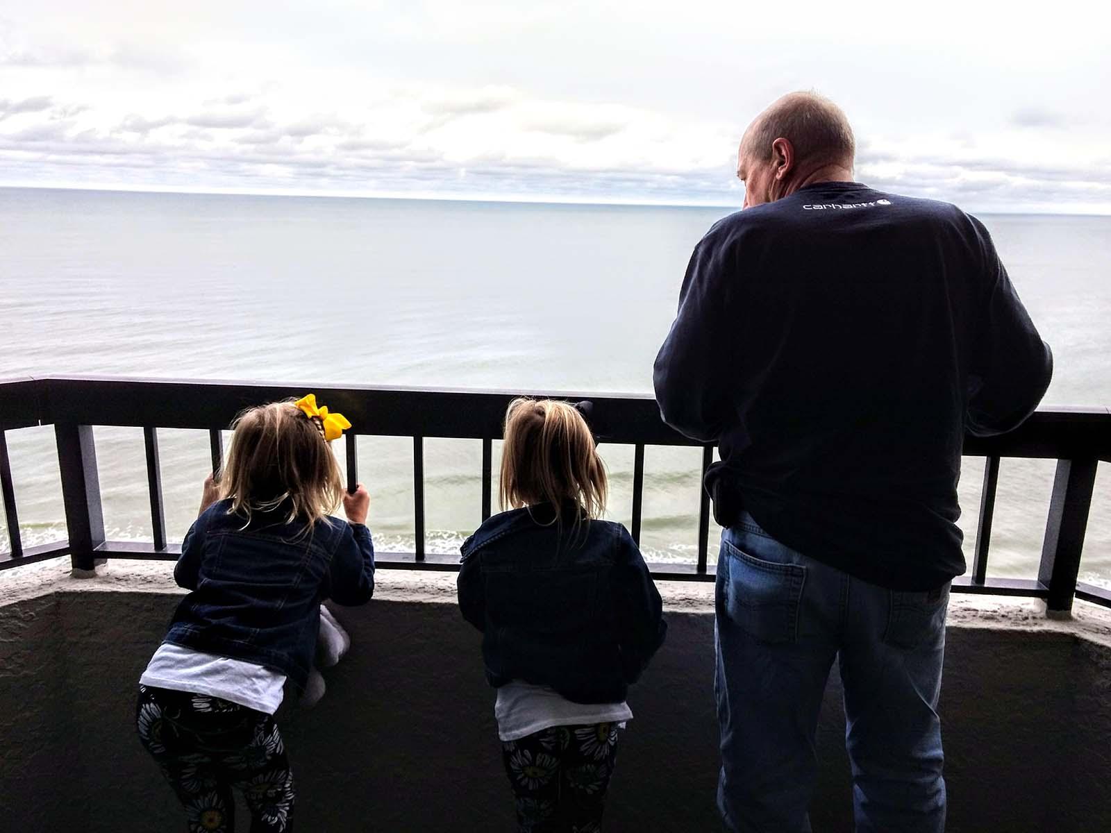 Grandpa with two grandkids on balcony
