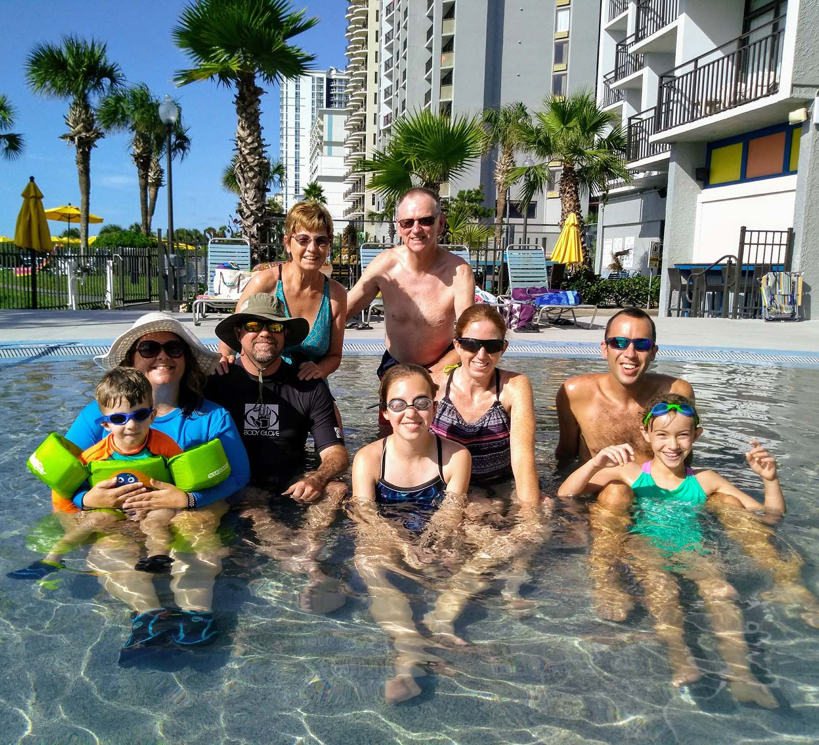 Big group family picture in pool
