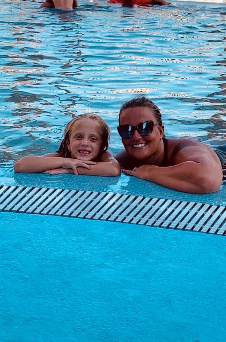Mom and Daughter posing in pool