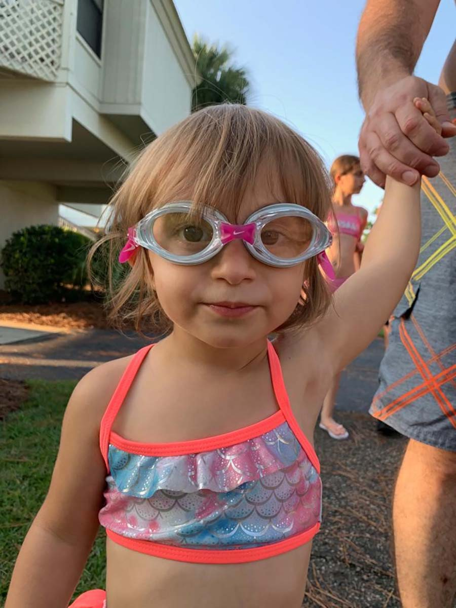 Little girl wearing goggles in bathing suit
