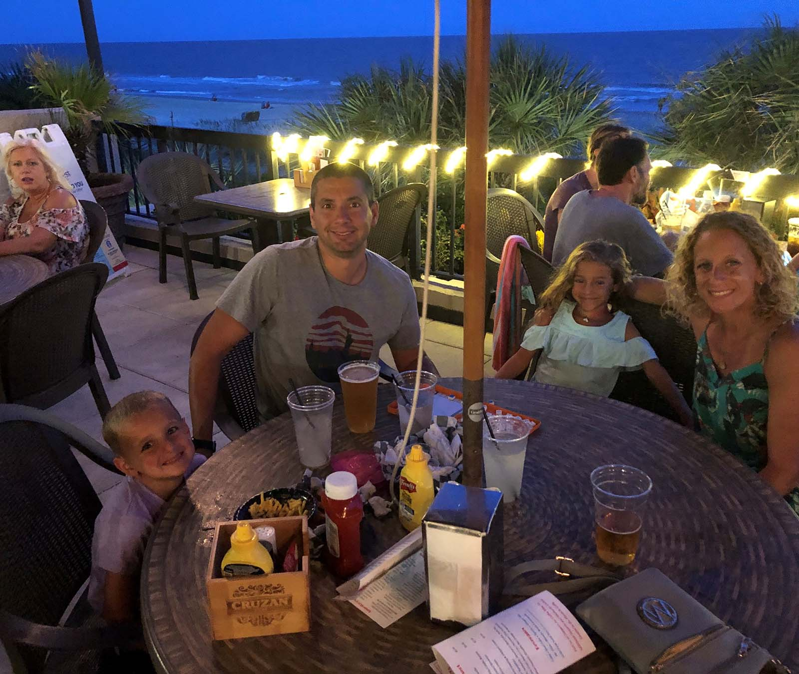 Family eating at Crows Nest at night