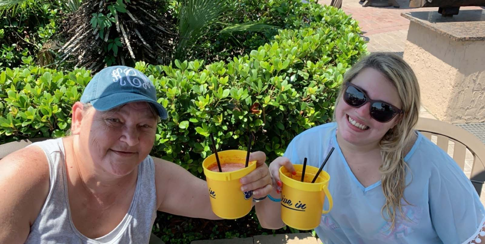 Two older ladies sipping on voodoo buckets