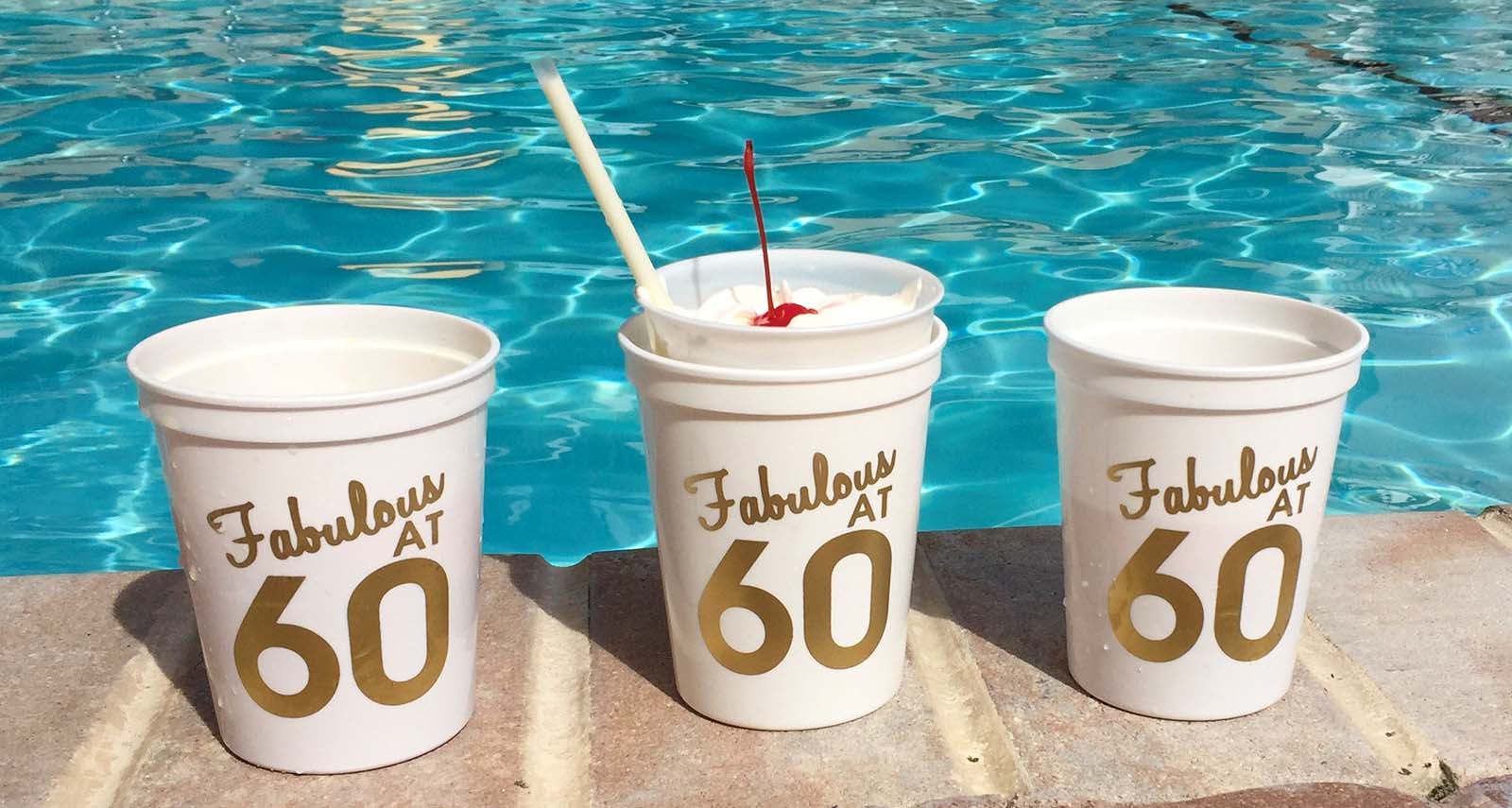 "3 ""60"" cups by pool"