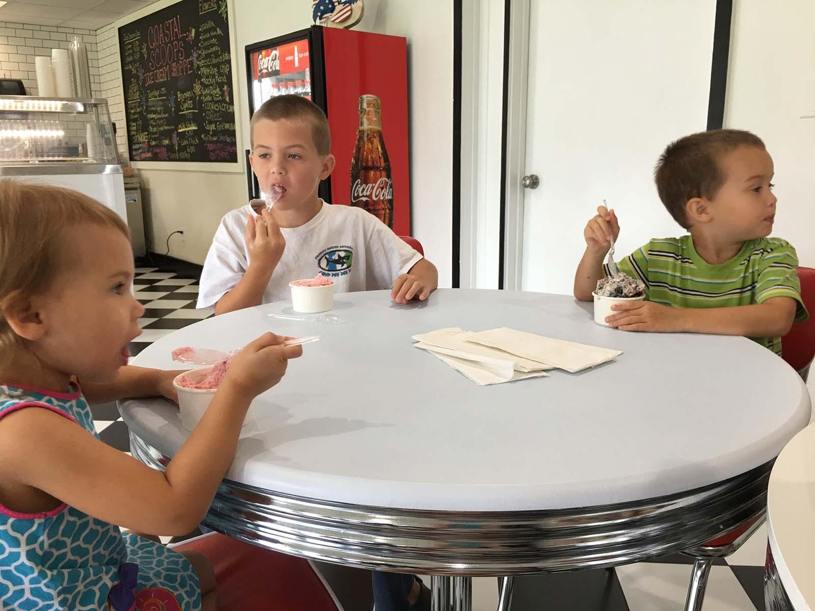 Siblings eating ice cream in coastal scoops