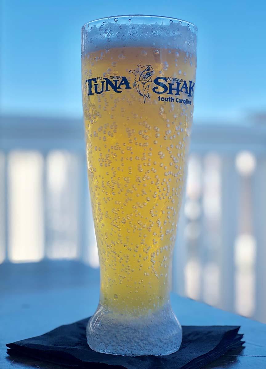 Tall beer glass with Tuna Shak logo