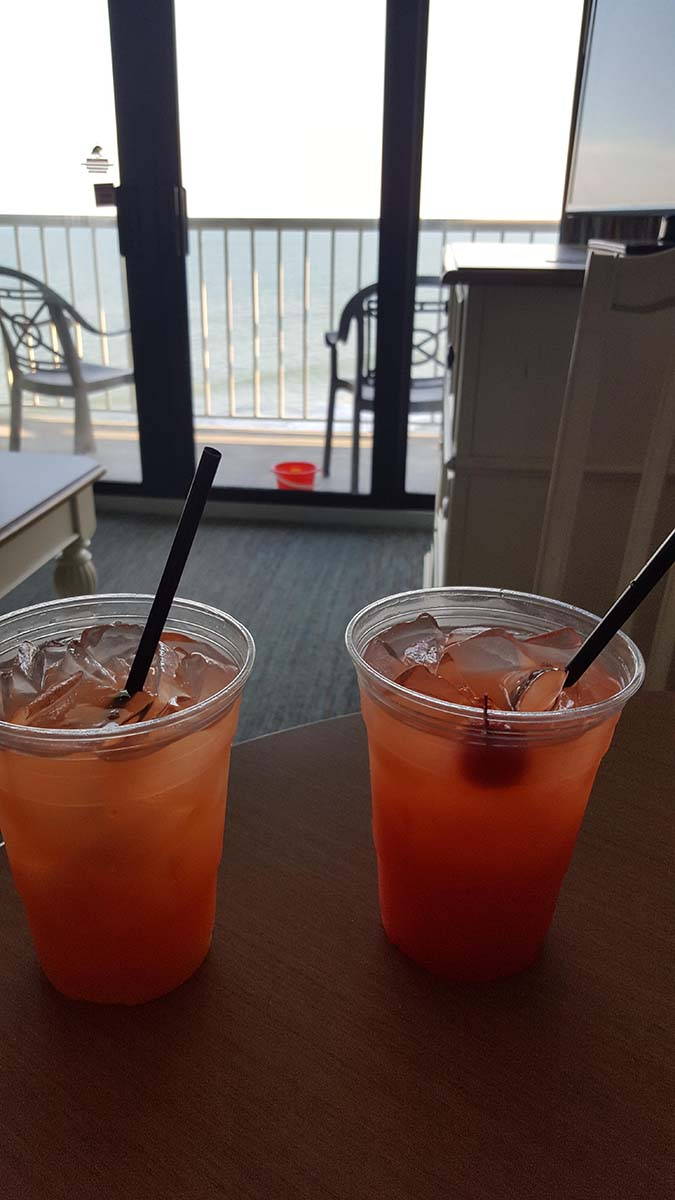 Picture of drinks in room with balcony in background