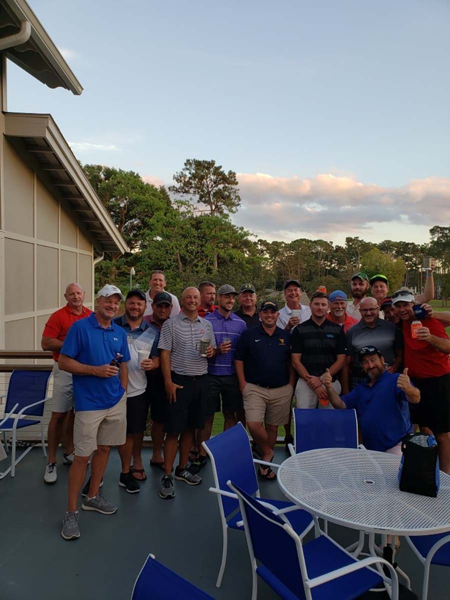 Group of guys at gof course