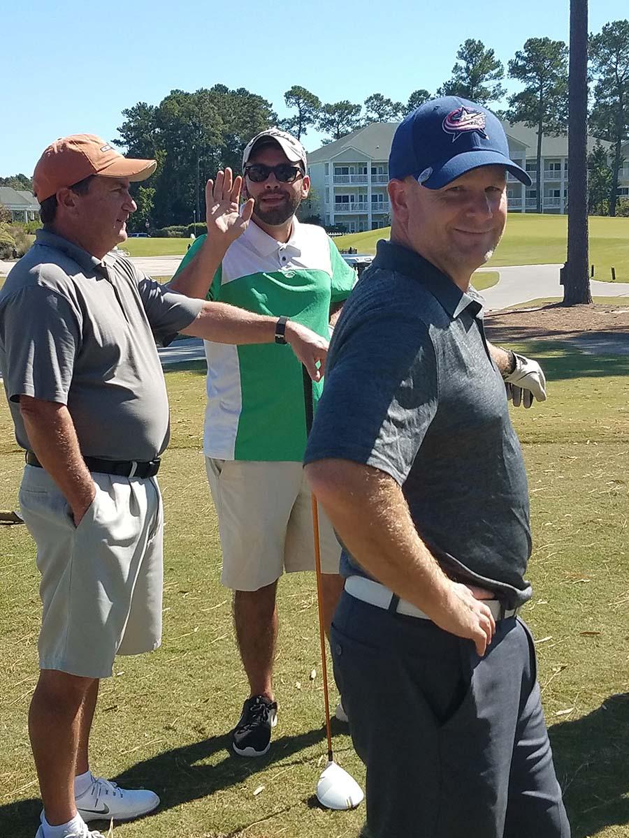 3 guys golfing