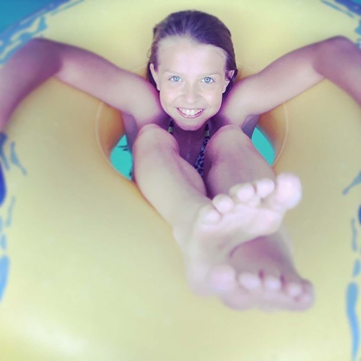 girl sitting in tube in the lazy river
