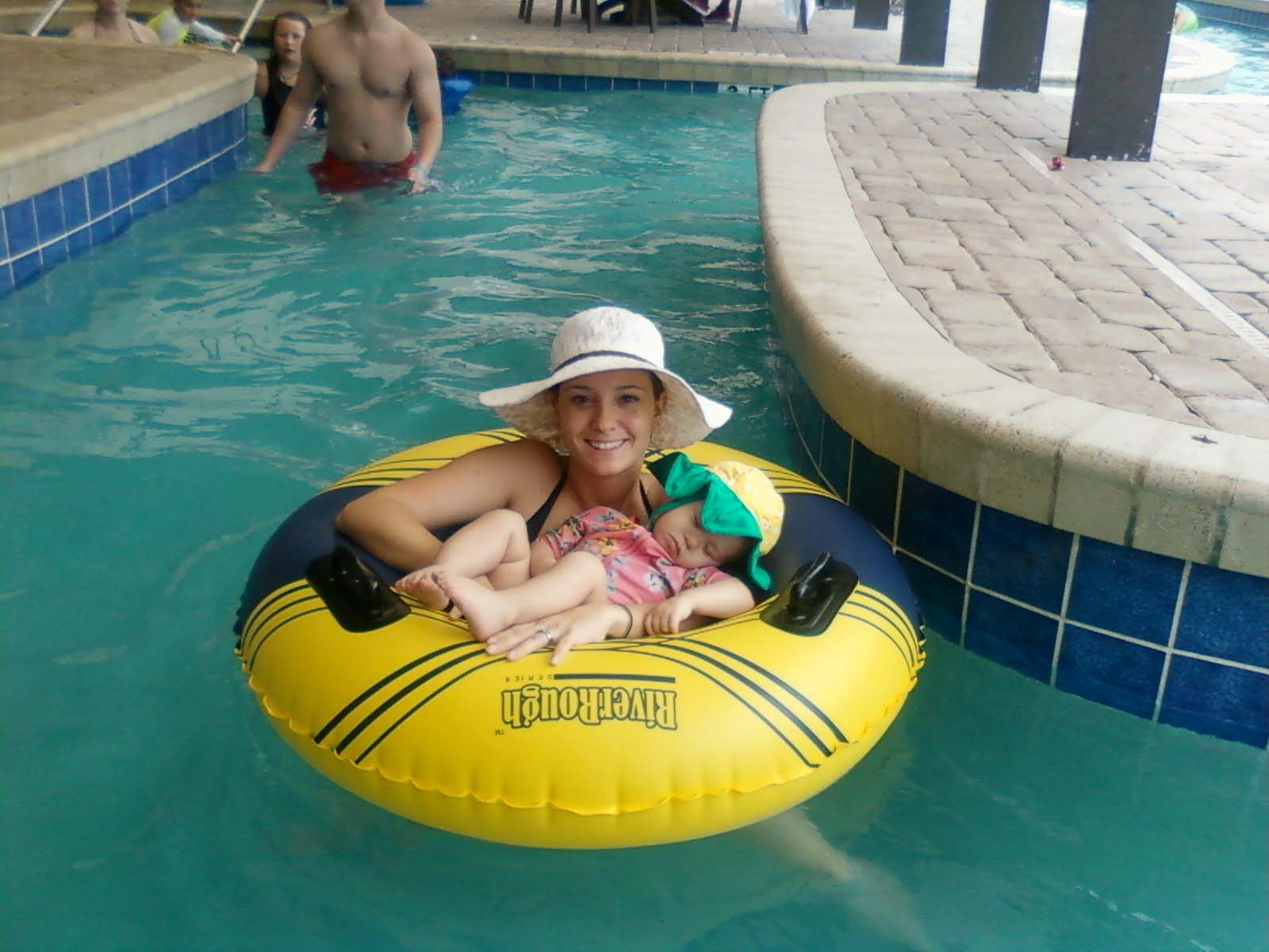 baby relaxing with mom in tube in the lazy river
