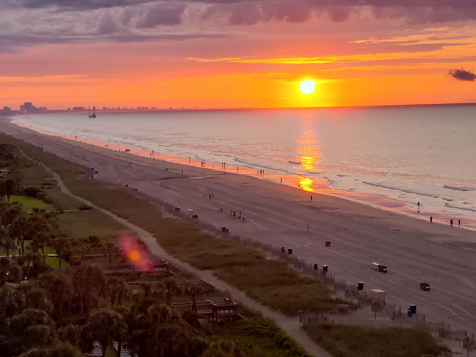 large beach sunrise from balcony
