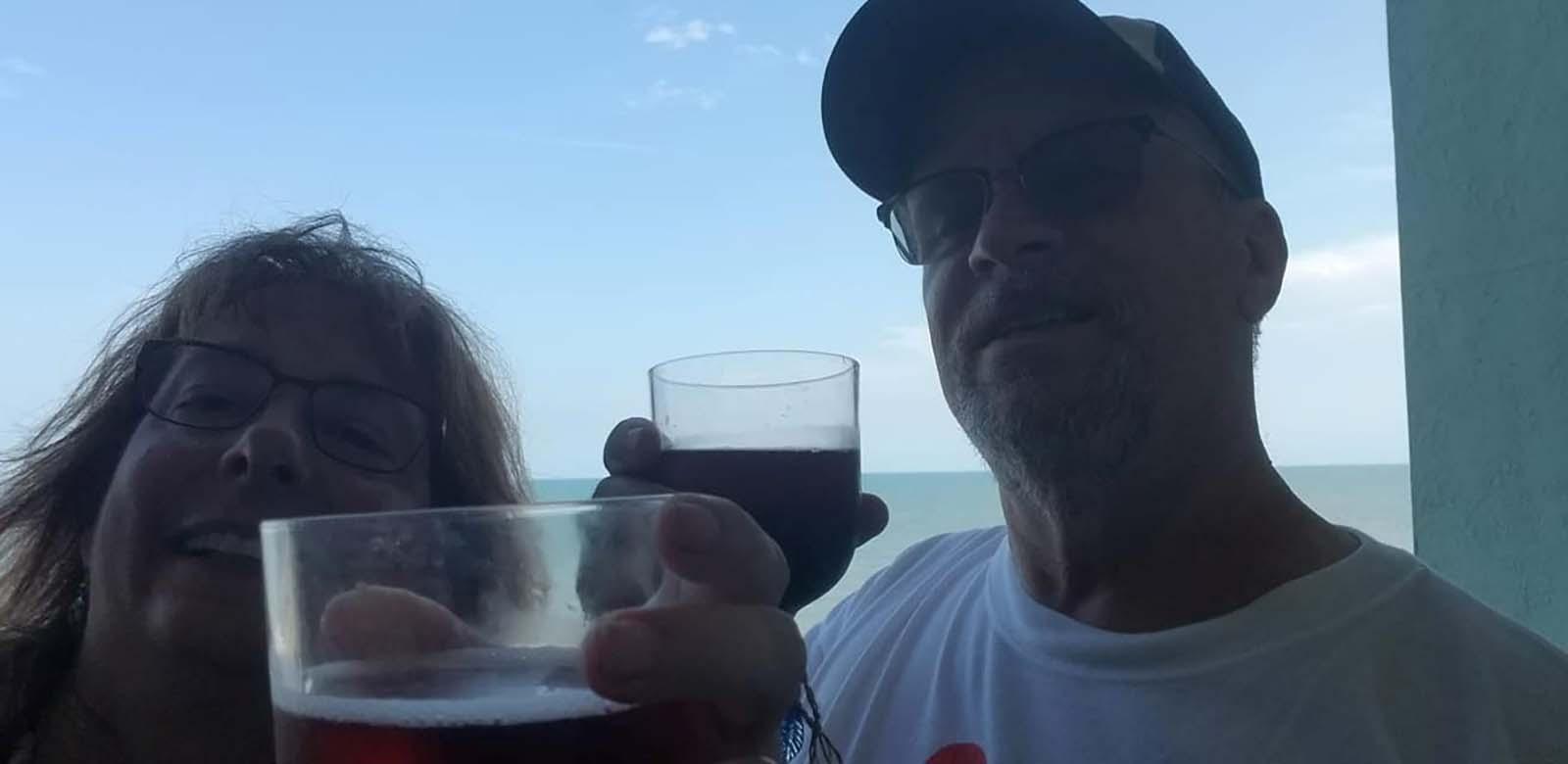 couple drinking on balcony