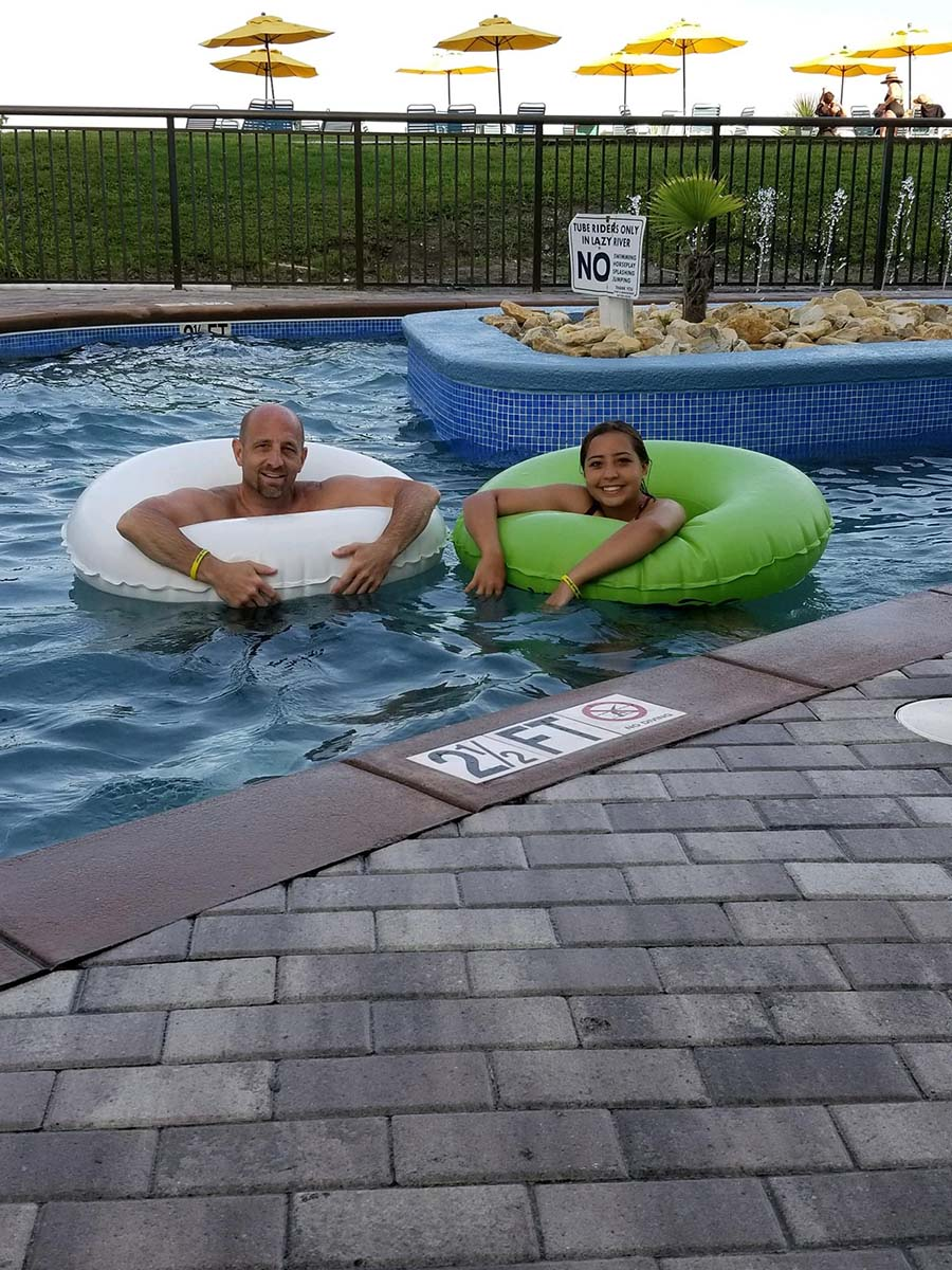 Dad and daughter in tubes in lazy river