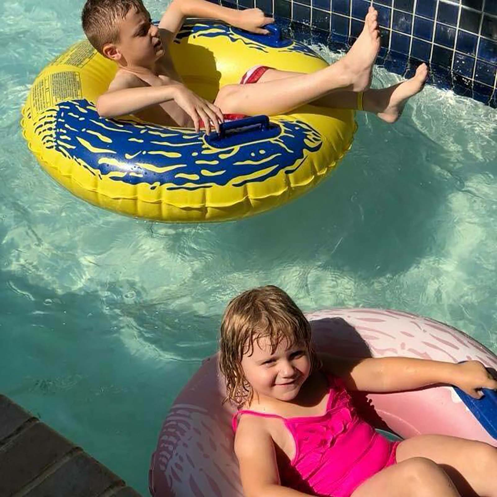 Boy and girl in tubes in lazy river