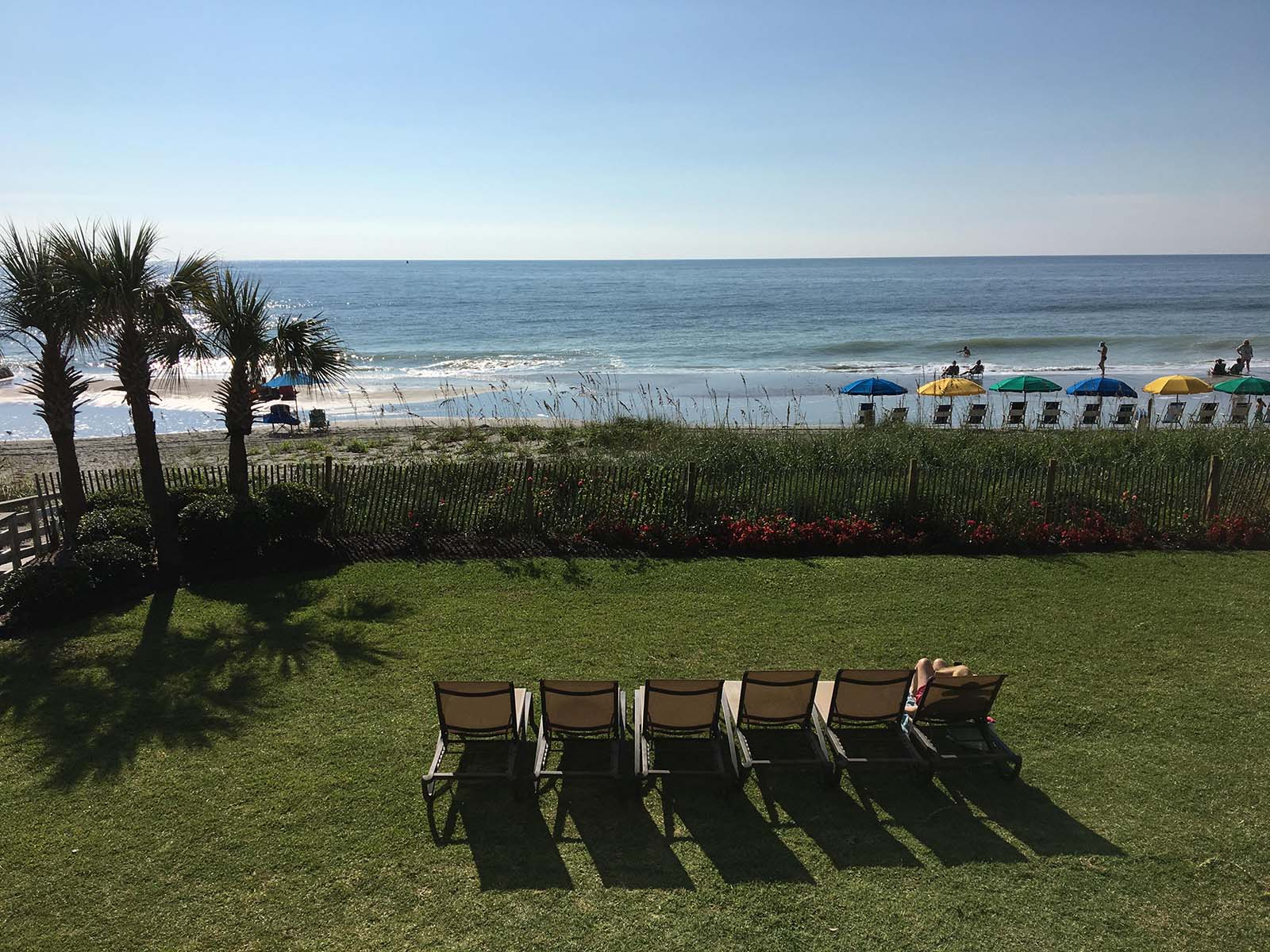 Photo of view with empty lawn chairs