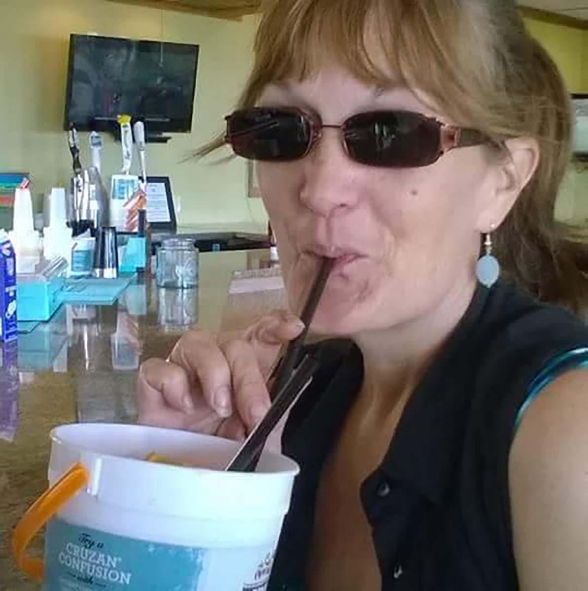 Lady drinking voodoo bucket at the bar