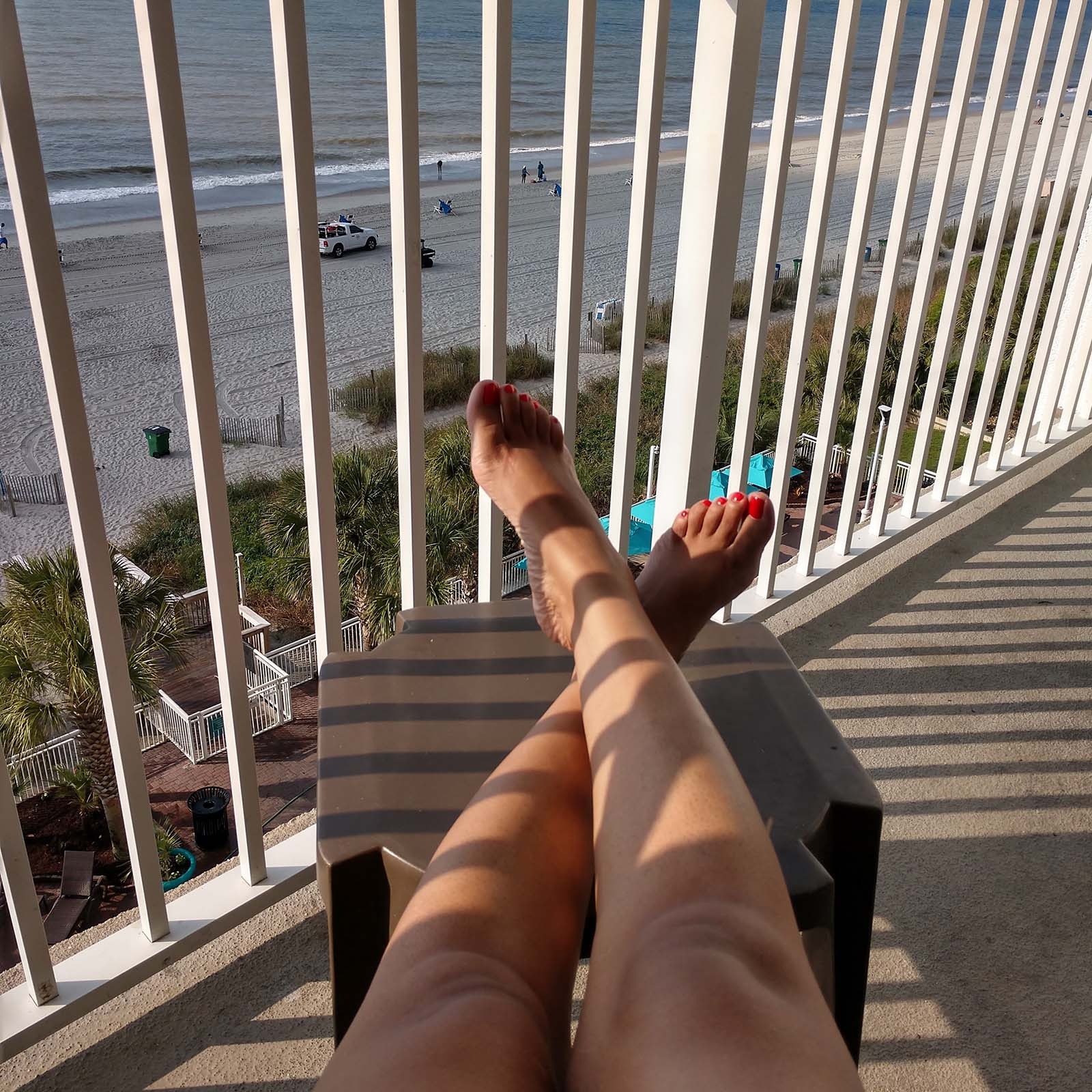 Legs crossed on balcont relaxing