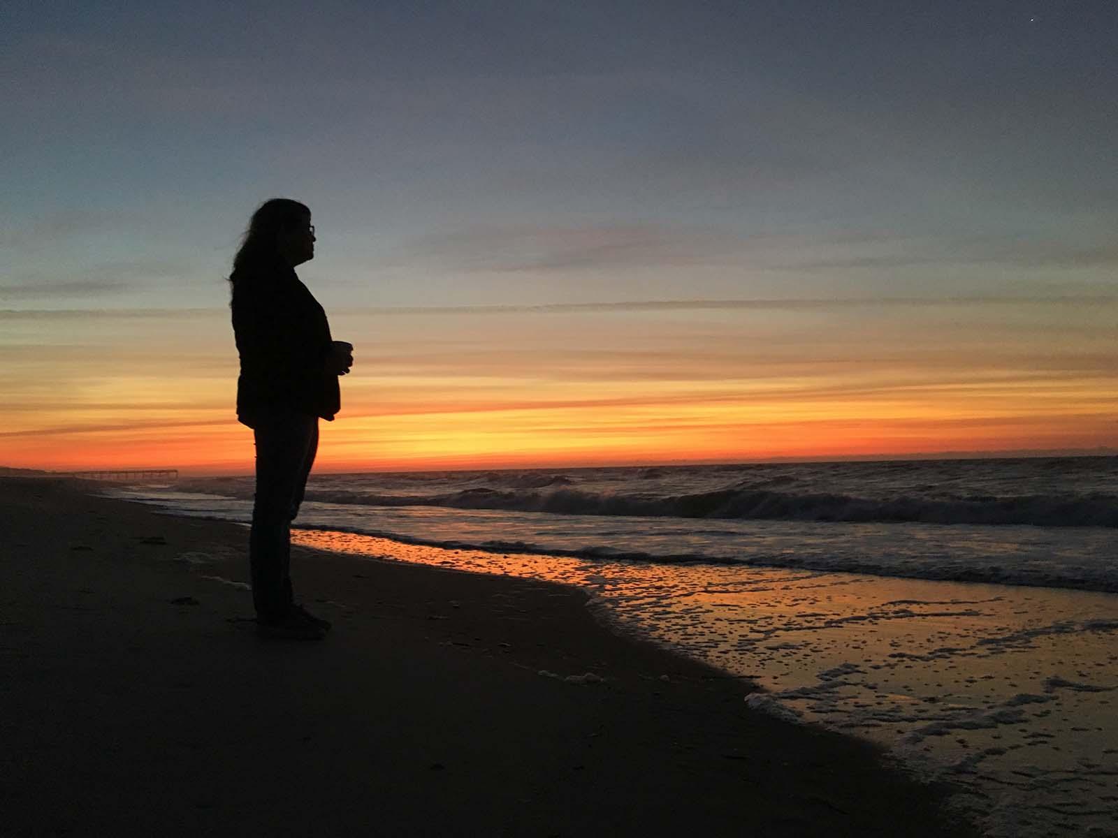 Girl at sunrise on the beach