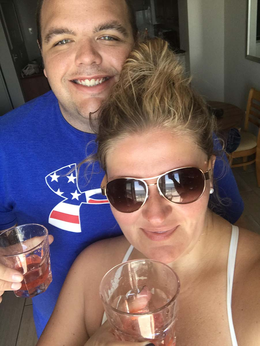 Couple taking a selfie with drinks