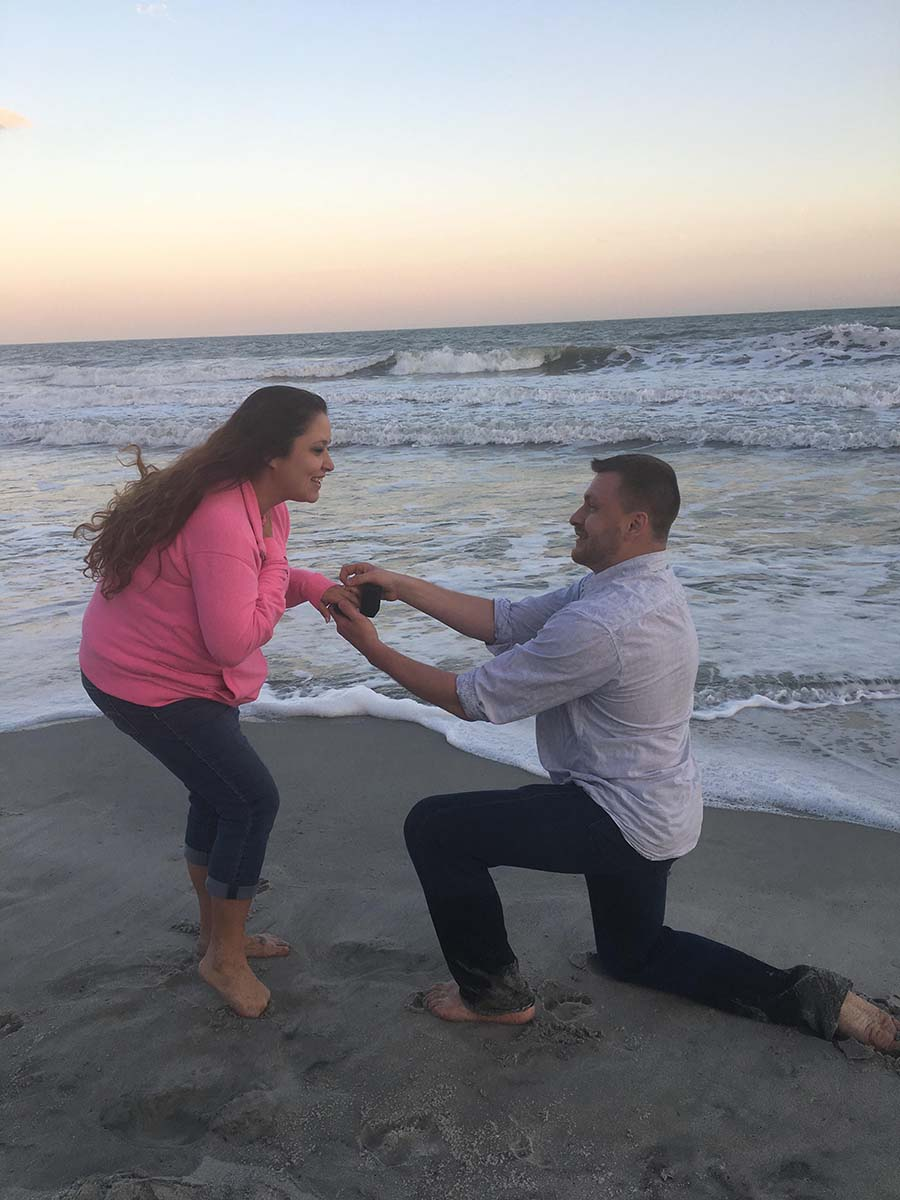 man proposing on the beach (both in pants)