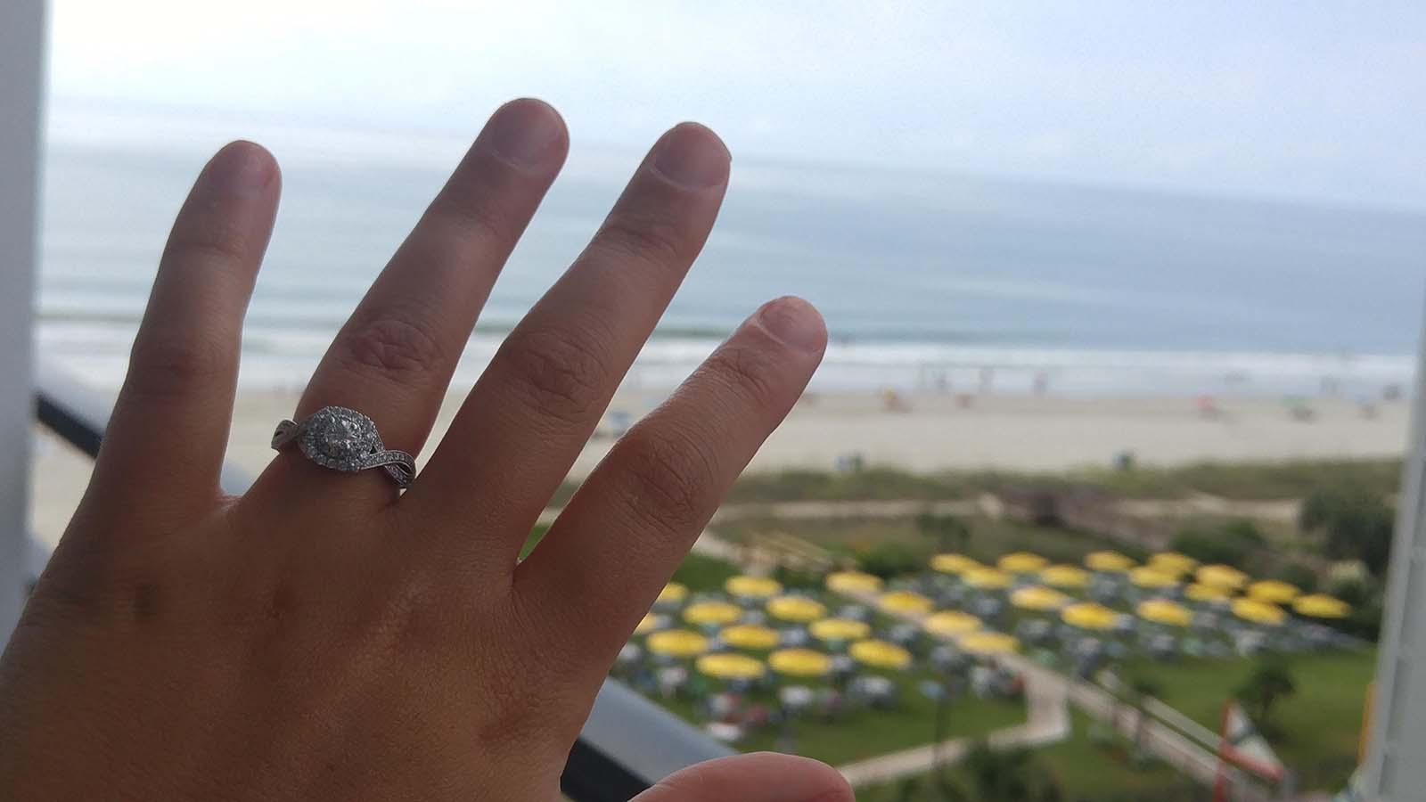 Woman flashing wedding ring on blacony