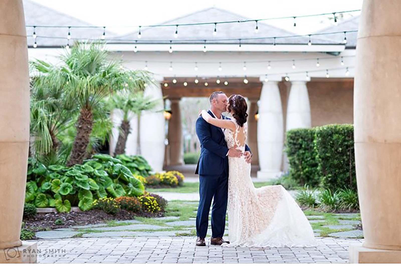Couple kissing at 21 Main courtyard