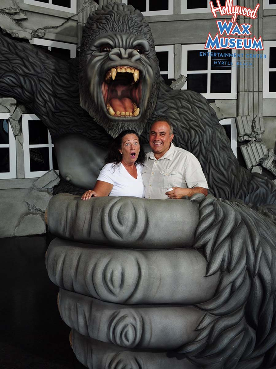 Couple at wax museum in gorilla