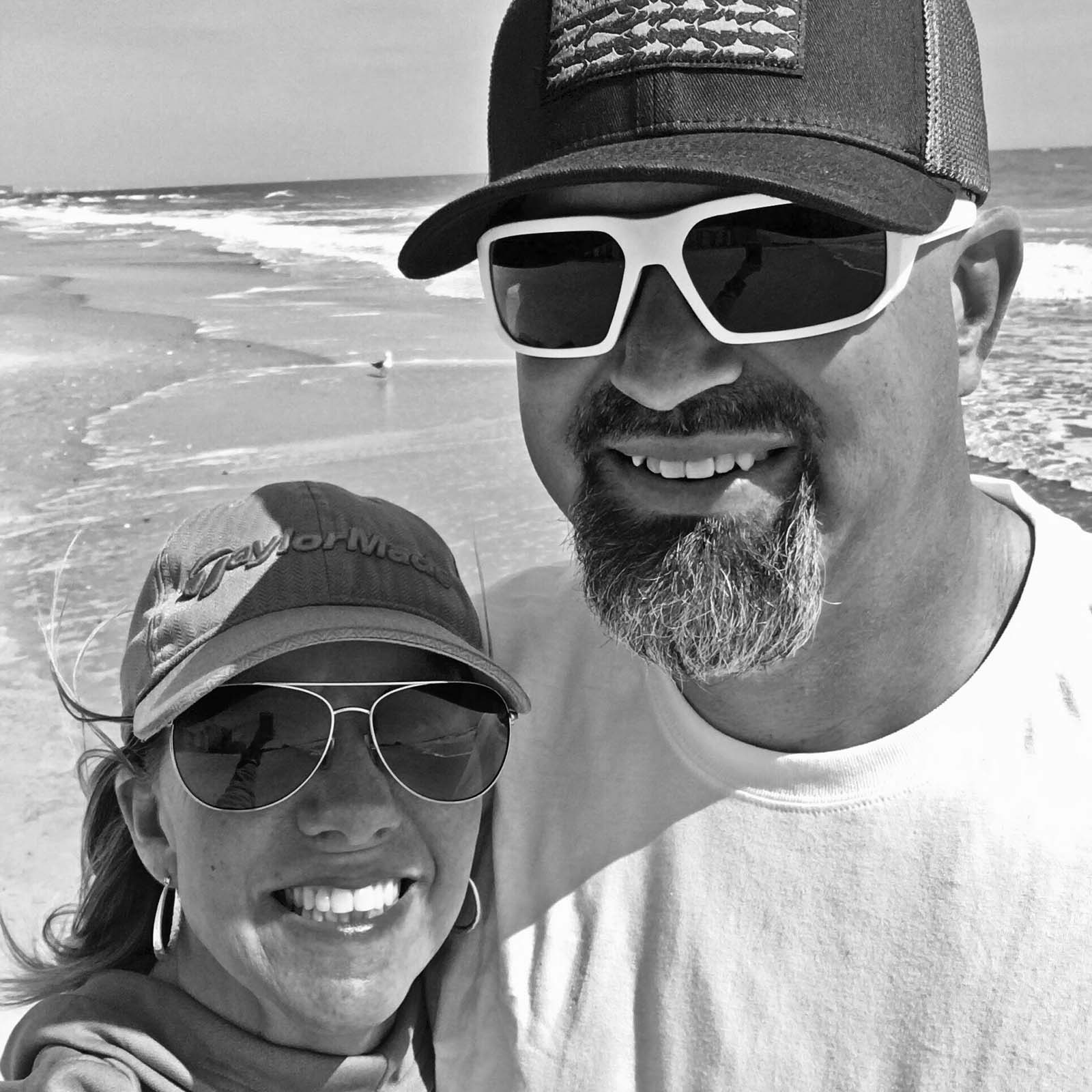 Black and white photo of couple on beach