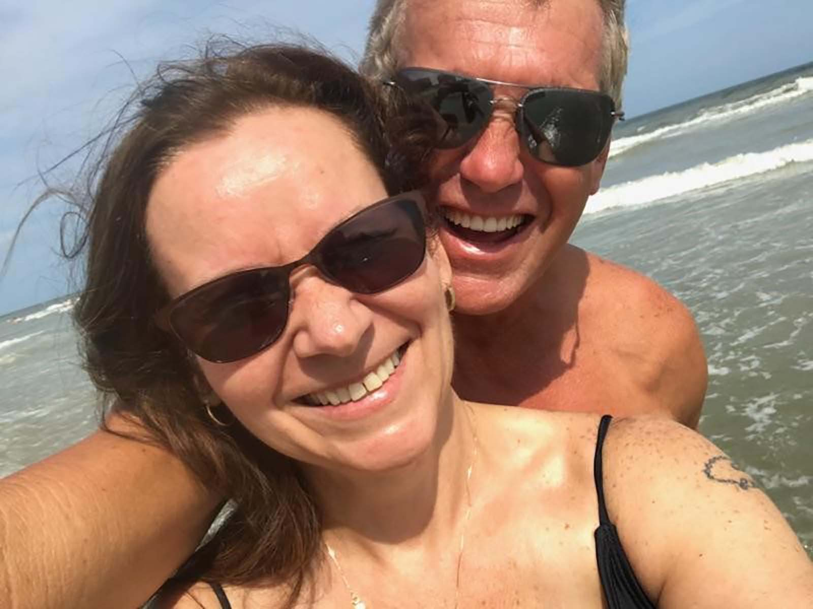 Couple taking picture on beach