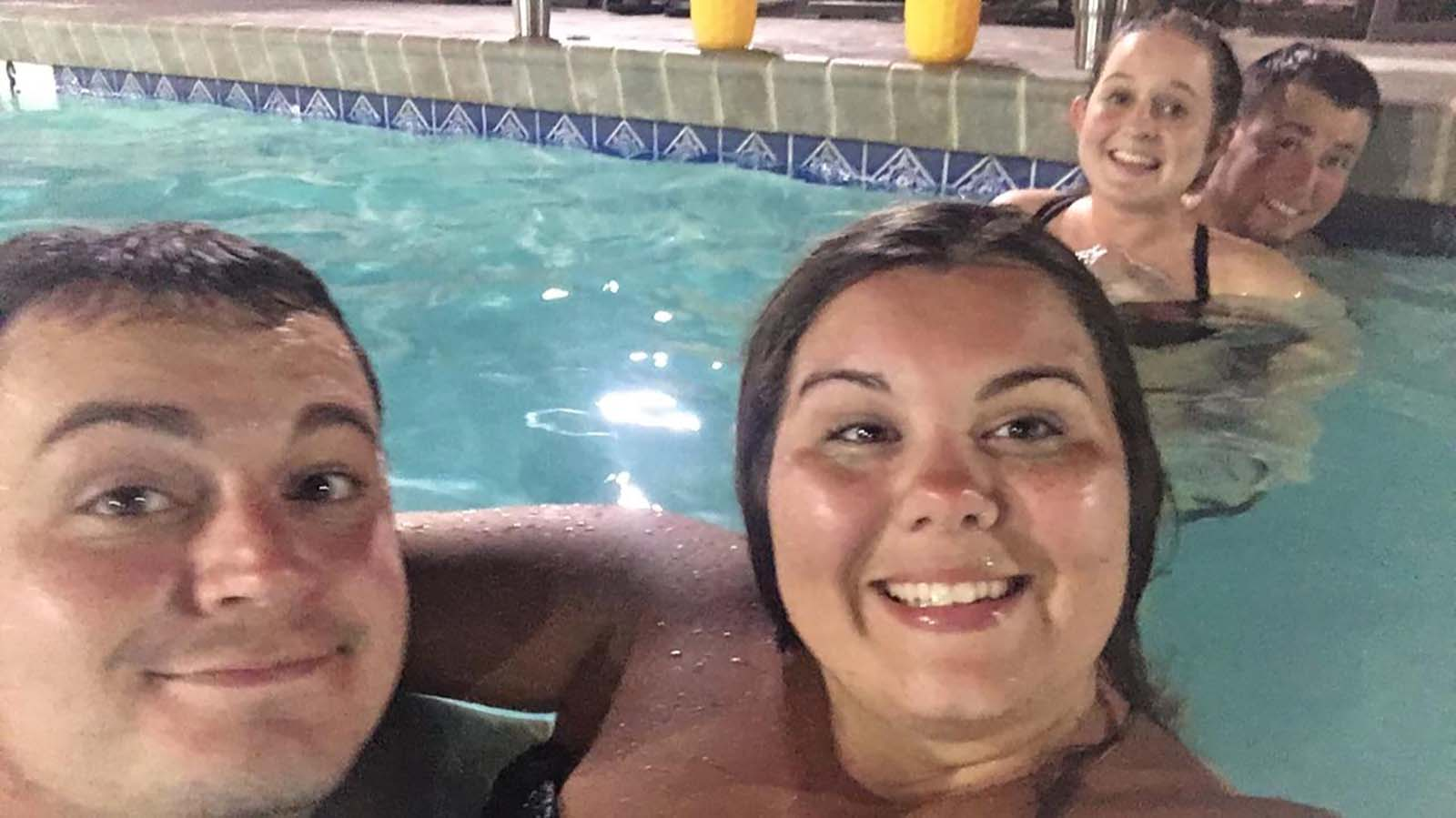Couples in pool together