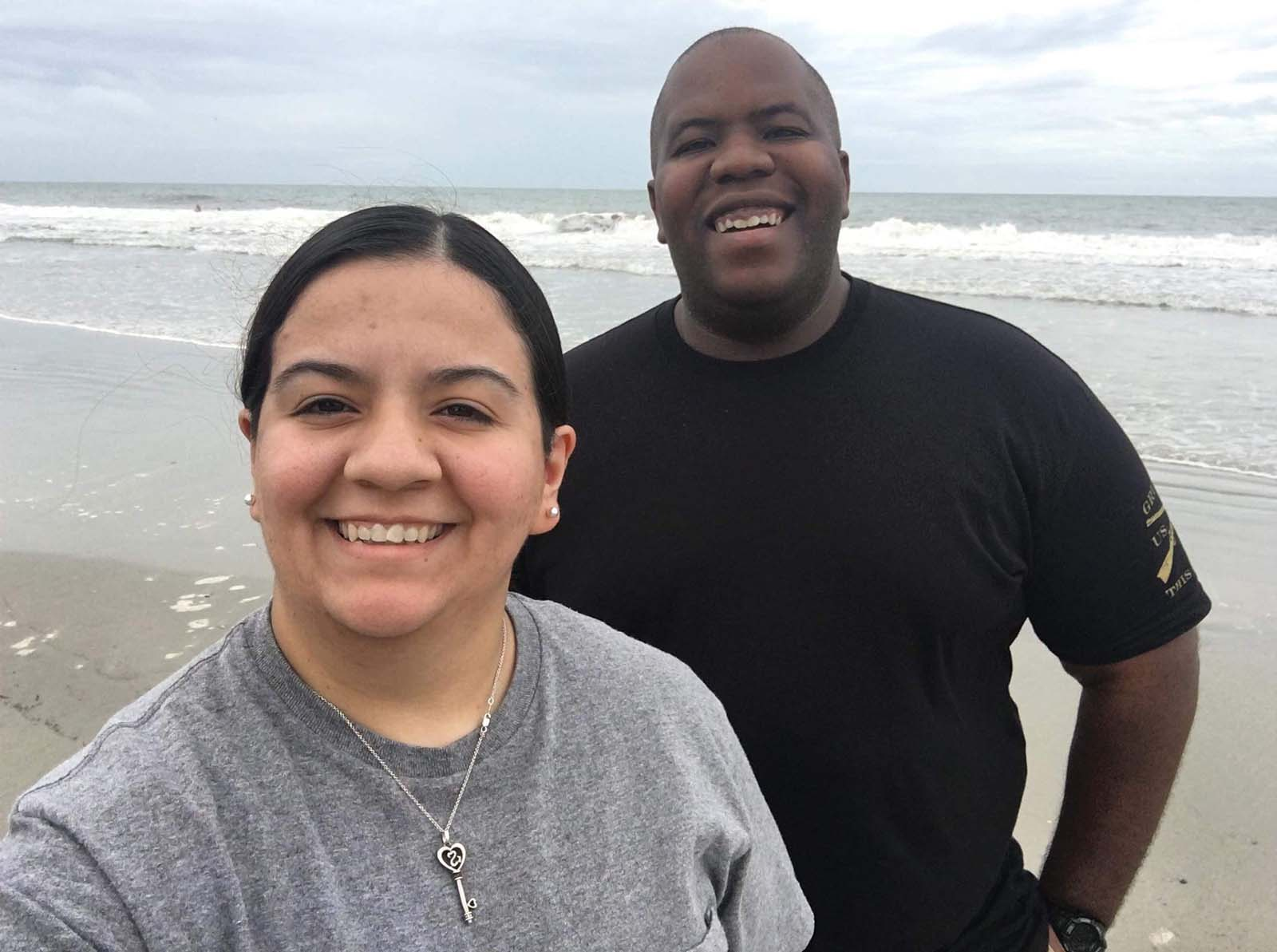 Couple smiling together on the beach