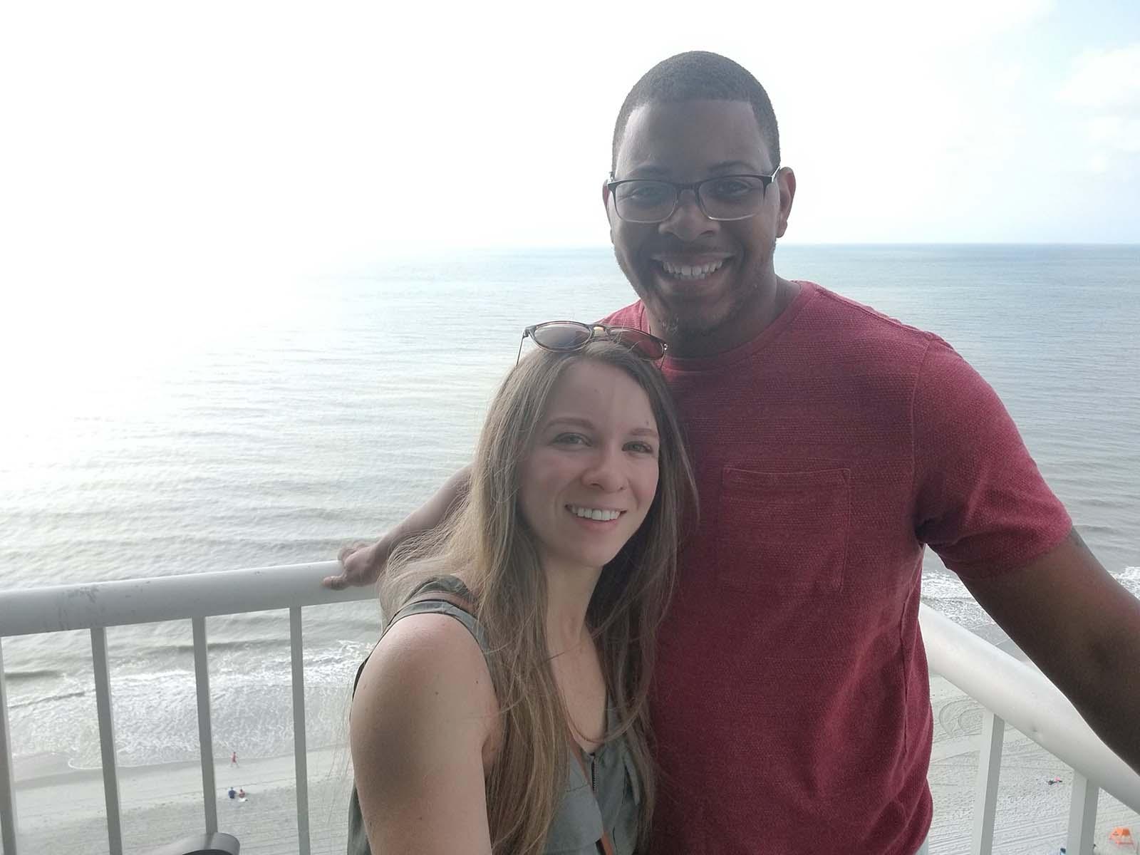 Couple taking photo together on balcony