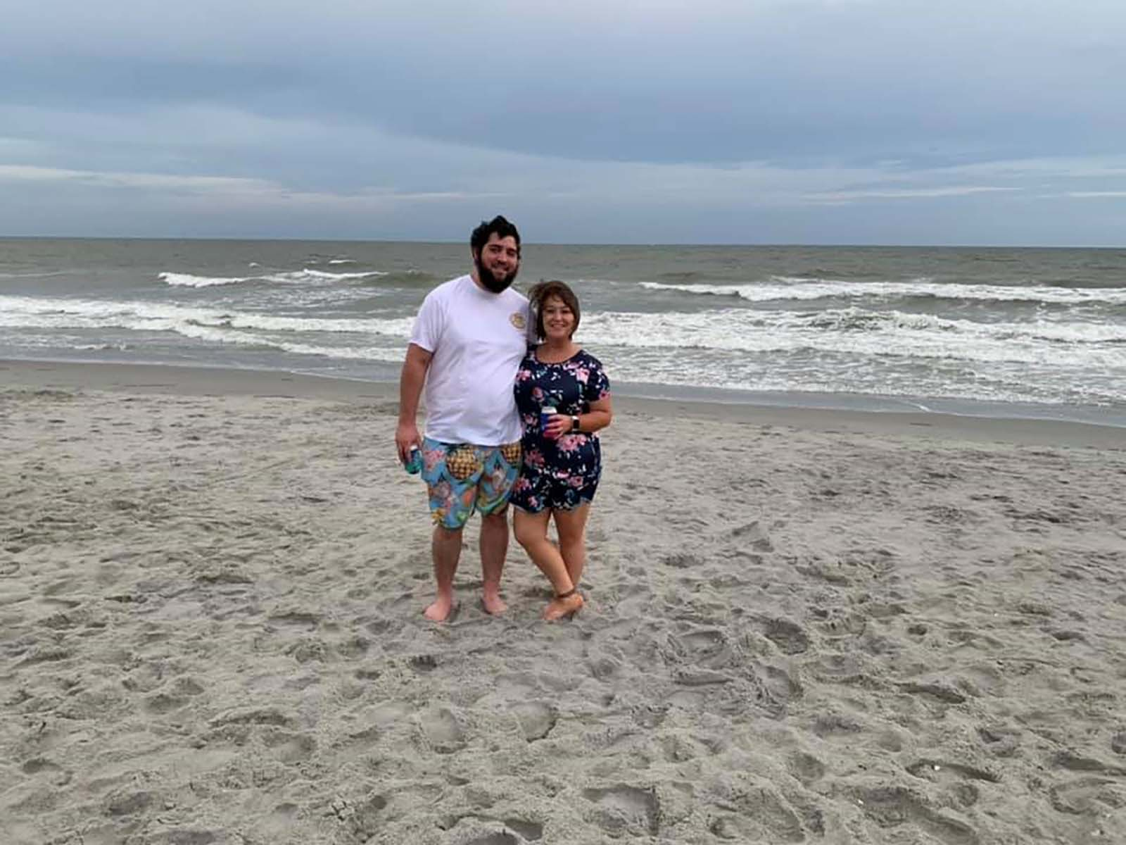 Couple on beach taking picture together